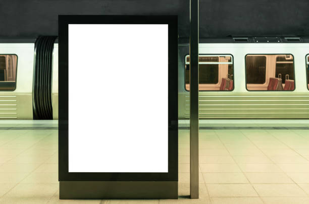 illuminated digital billboard in underground train station mockup illuminated digital billboard in underground train station mockup underground stock pictures, royalty-free photos & images