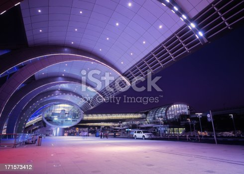 Illuminated Dubai International Airport at dusk, UAE. High-end scan of 6x7cm transparency.View more related images in one of the following lightboxes: