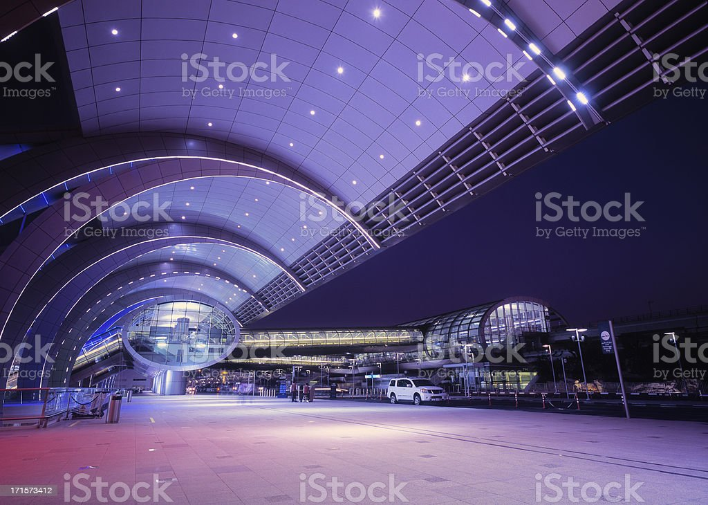 Illuminated Dubai International Airport at dusk, UAE stock photo