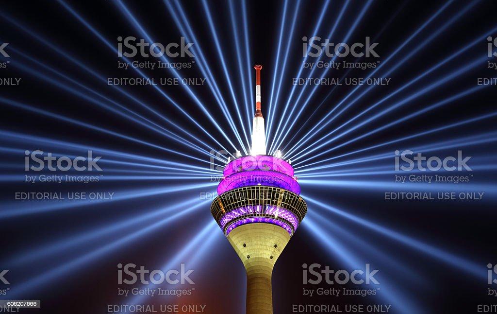 Illuminated Duesseldorf Rheinturm tower stock photo