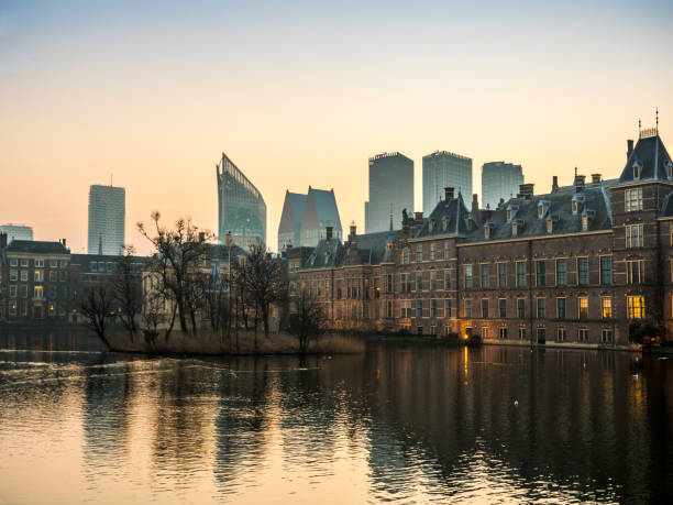 Illuminated Dutch parliament buildings in The Hague, early morning. The Netherlands stock photo