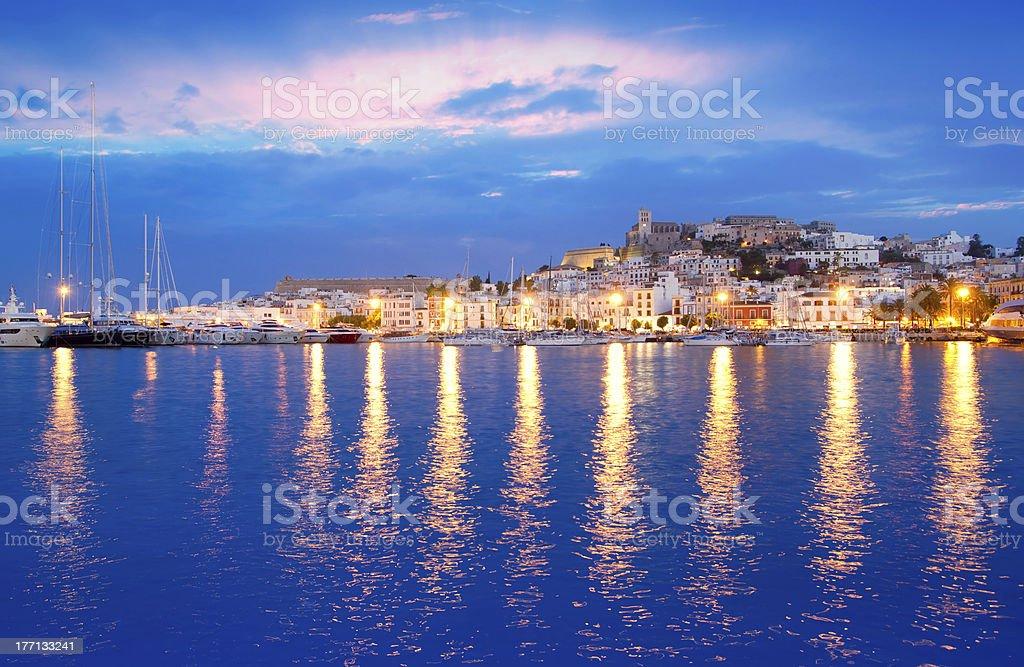Illuminated Eivissa town at night as seen from Ibiza island stock photo
