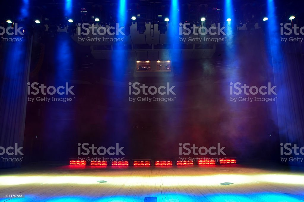 Illuminated empty concert stage with smoke stock photo