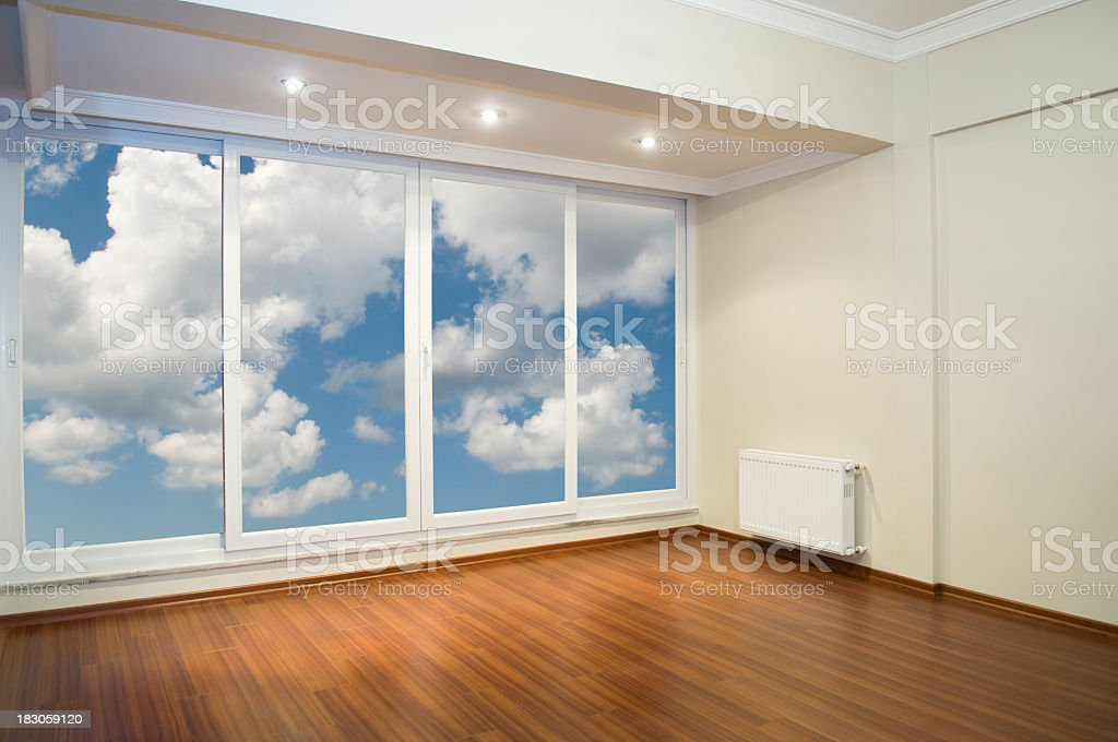 Illuminated empty room with a large glass front royalty-free stock photo