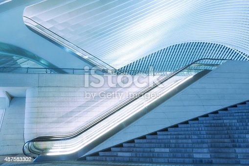 istock Illuminated Escalator Outside Futuristic Train Station Illuminated at Night 487583302