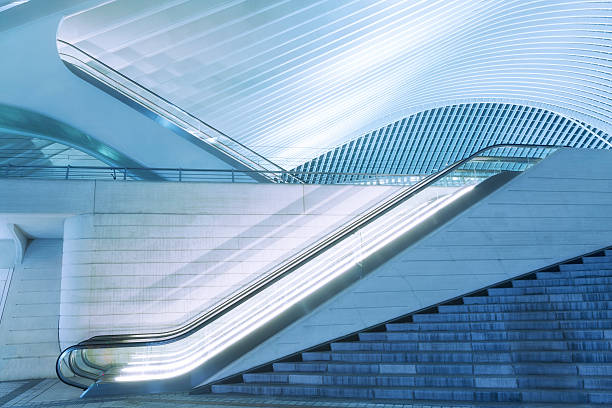 Illuminated Escalator Outside Futuristic Train Station Illuminated at Night illuminated escalator outside futuristic railroad station at dusk, Liege, Guillemins, Belgium lulik stock pictures, royalty-free photos & images