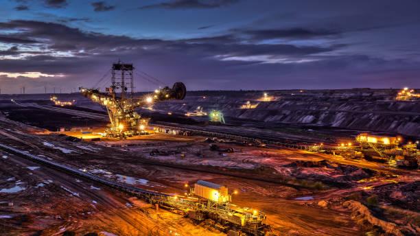 Illuminated Excavator Night Shot of Open Surface Coal Mining Garzweiler Germany stock photo
