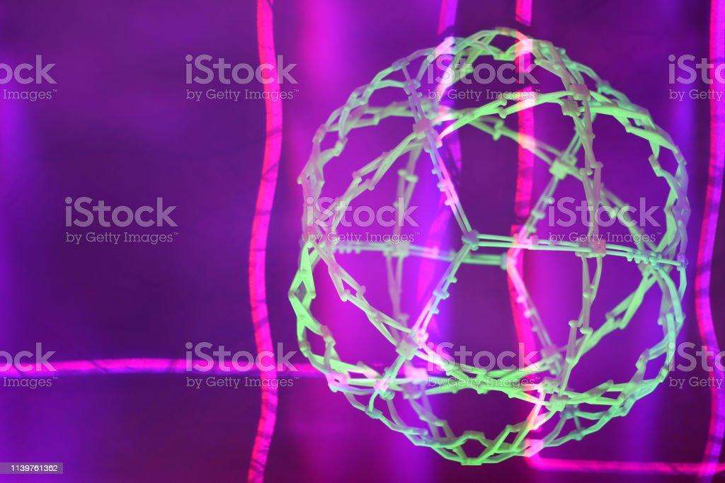 UV Illuminated Expanding Sphere with Magenta Laser and Haze stock photo