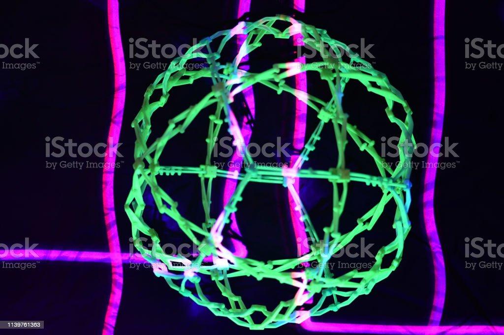 UV Illuminated Expanding Sphere with Magenta Laser stock photo