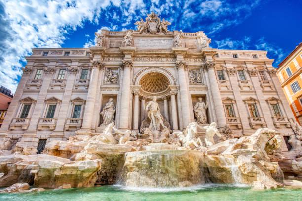 Illuminated Fontana Di Trevi, Trevi Fountain during a Sunny Day, Rome, Italy stock photo