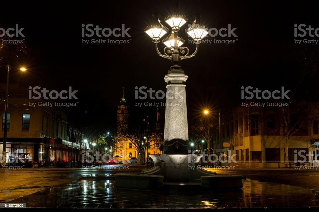 Illuminated fountain at night stock photo
