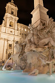 istock Illuminated Fountain of the Four Rivers  in Rome in the night. Vertically. 1046958082