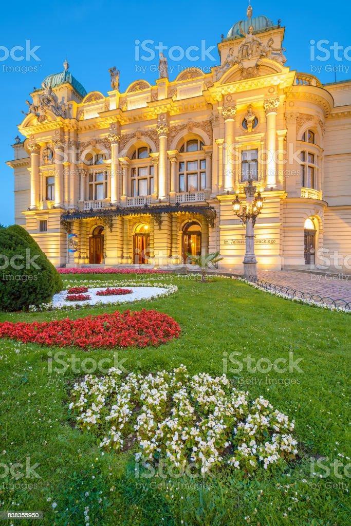 Illuminated front facade of Slowackiego Theatre in Krakow, Poland stock photo