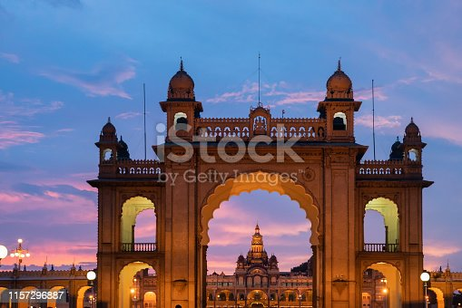 Illuminated front gate of Mysore palace, with Mysore palace in the background.This is a historical palace and a royal residence, Karnataka, India.