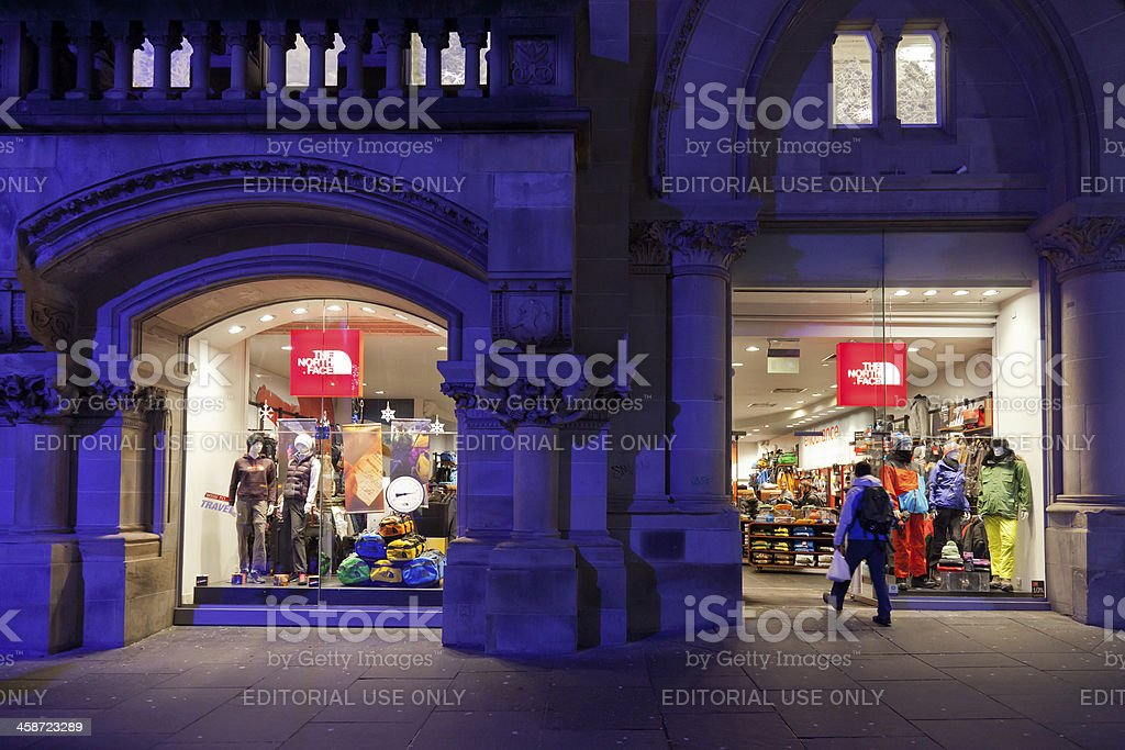 Illuminated frontage of The North Face shop, Glasgow, Scotland