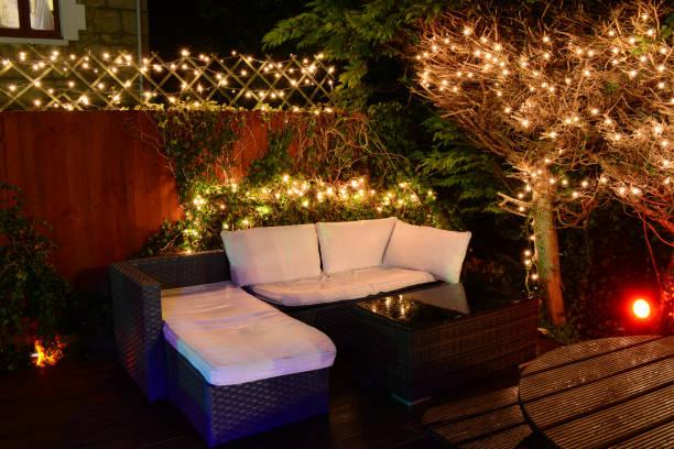 Illuminated Garden Seating and Fairy Lights stock photo