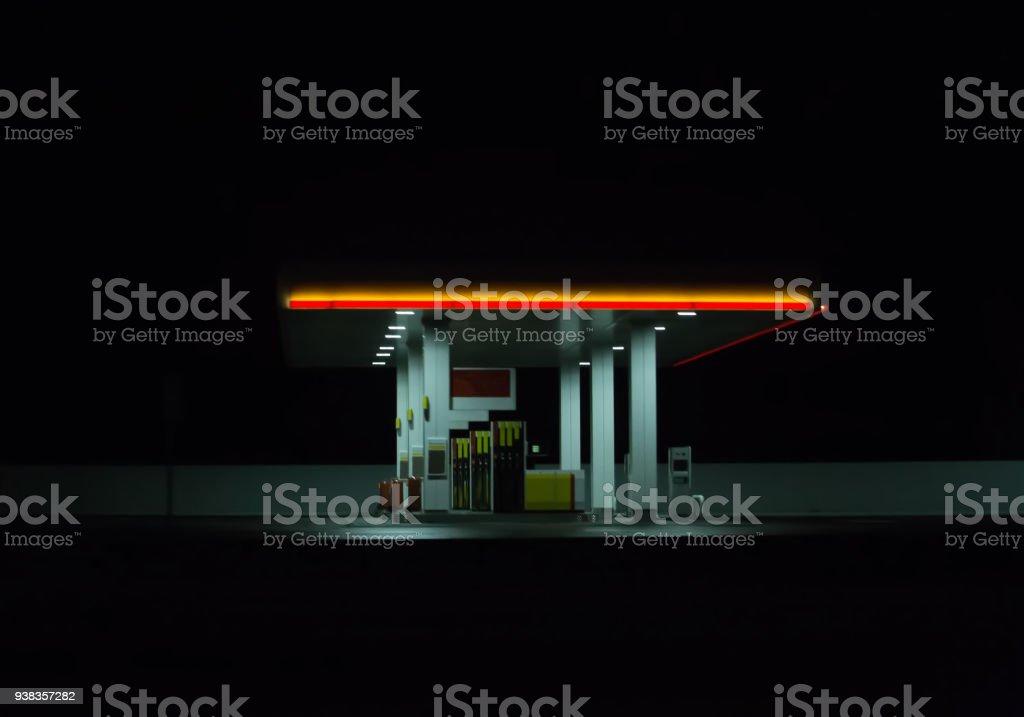 Illuminated gas station at night. stock photo