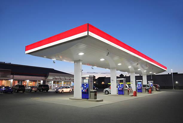 Illuminated Gas Station at Sunset stock photo