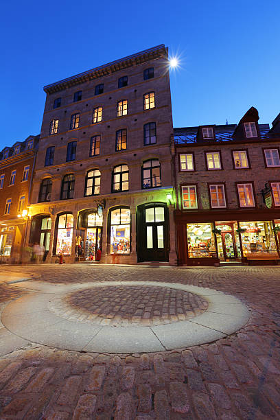 Illuminated Gift Shop in the Old Quebec City at Sunset stock photo