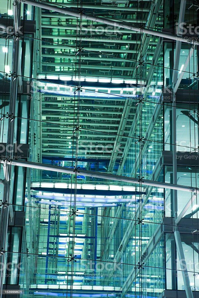 Illuminated glass office building at night, London, England royalty-free stock photo