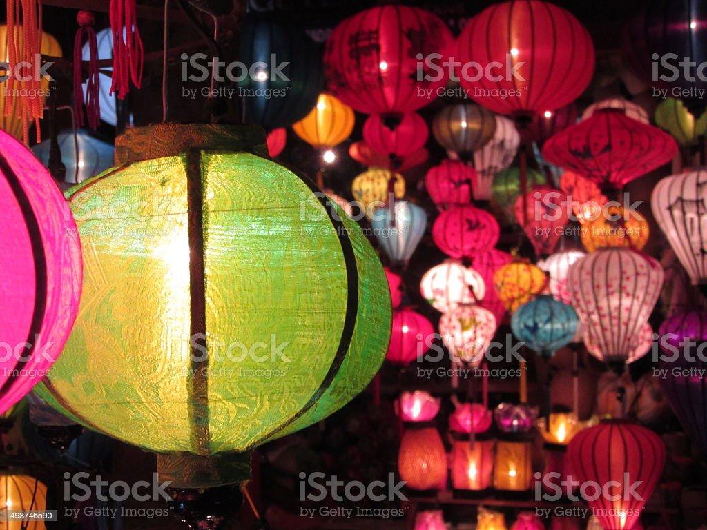 Illuminated Green Silk Lantern in Hoi An, Vietnam stock photo