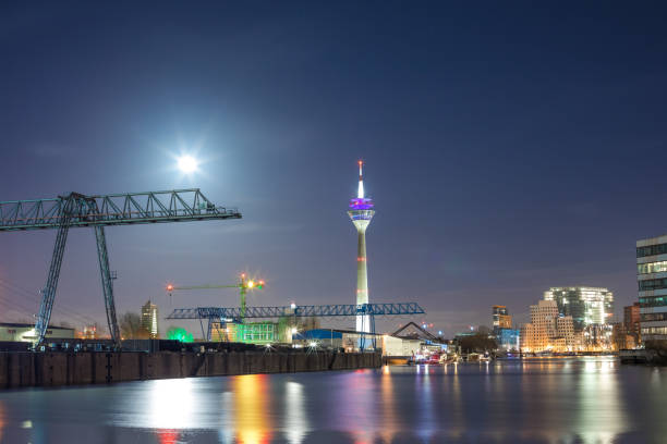 Illuminated Harbour With Rhinetower Of Duesseldorf At Night stock photo