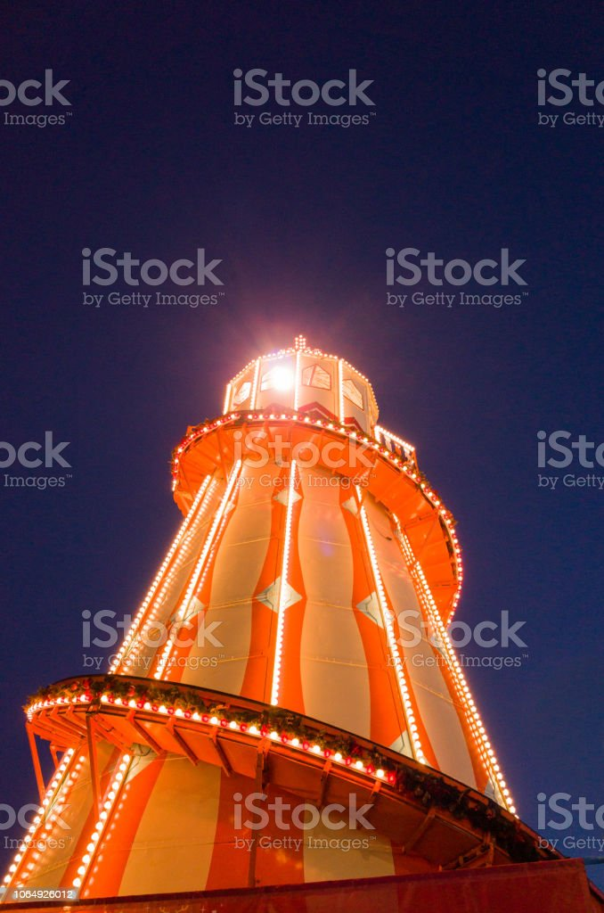 Illuminated Helter Skelter at Night stock photo