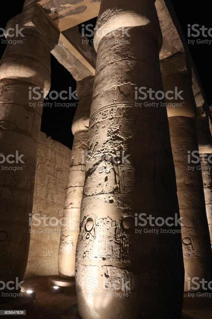 Illuminated hieroglyphic Column at temple of Luxor stock photo