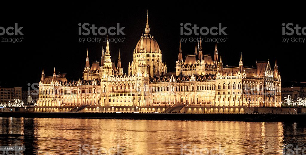 Illuminated historical building of Hungarian Parliament on Danube River Embankment royalty-free stock photo