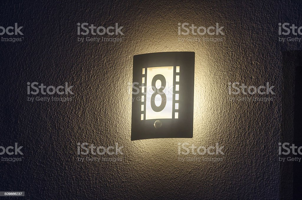 Illuminated house number, outdoor lamp stock photo