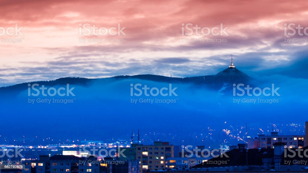 Illuminated Jested transmitter tower and hotel. Blue cloudy evening in Liberec, Czech Republic stock photo