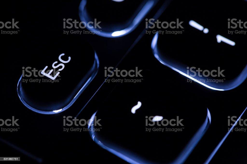 illuminated keyboard - 'ESC' key stock photo
