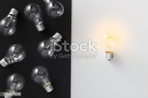 637573406 istock photo Illuminated lamp separated from other on contrast background 1133824026