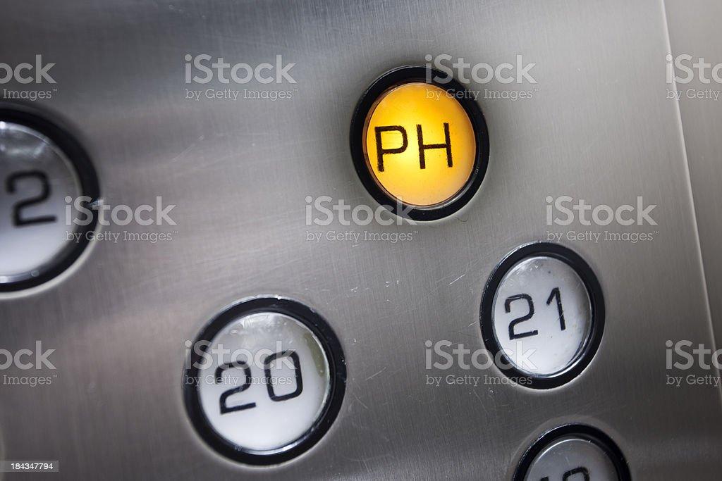 Illuminated lift button close-up stock photo