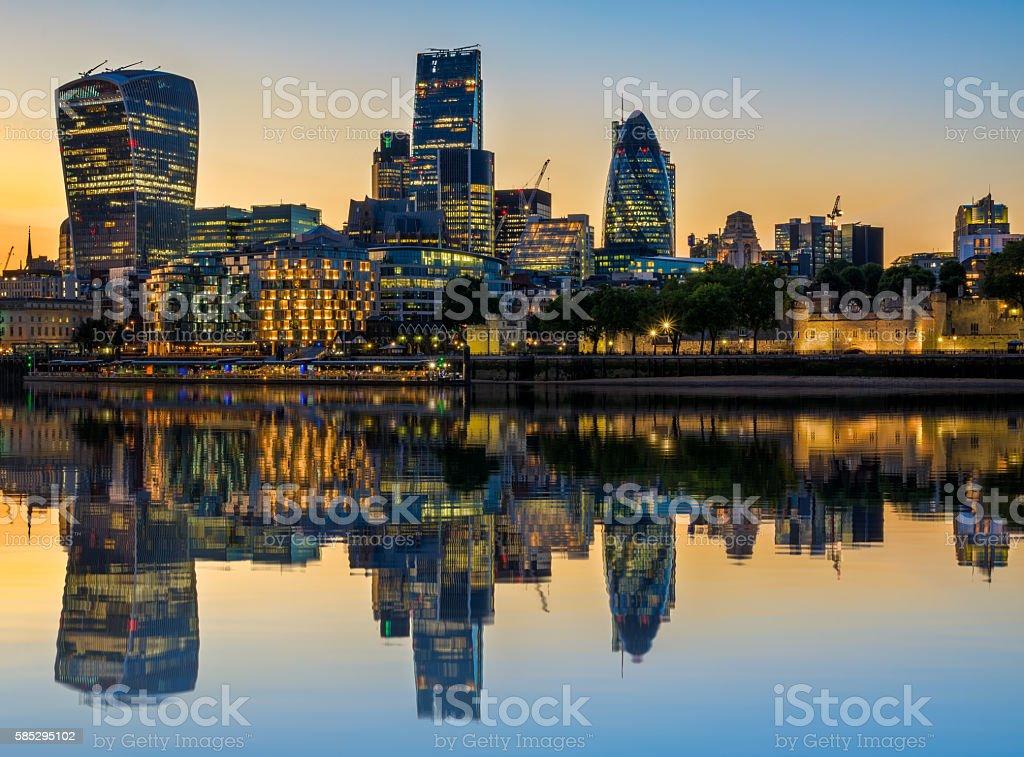 Illuminated London Cityscape at Sunset with Reflection stock photo