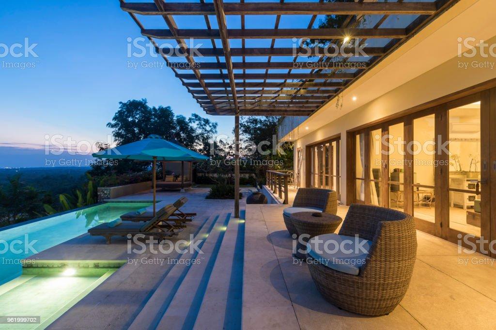 Illuminated Luxurious Villa With Swimming Pool At Sunrise ...