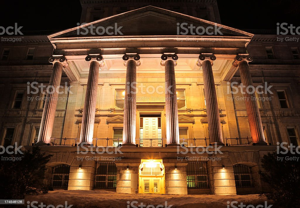 Illuminated Majestic Financial Building at Night stock photo