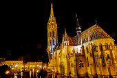 This pic shows night view of Matthias Church which is at buda side in budapest. The pic is taken night time and in January 2019. Illuminated Matthias Church looks stunning at night time.