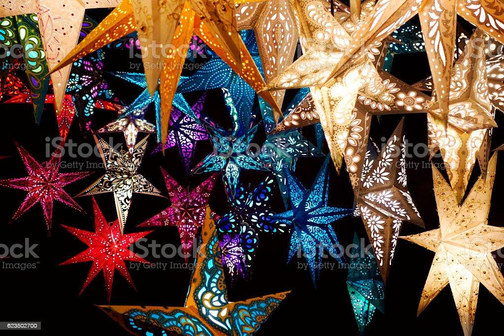 Illuminated moravian Christmas stars in amazing colors stock photo