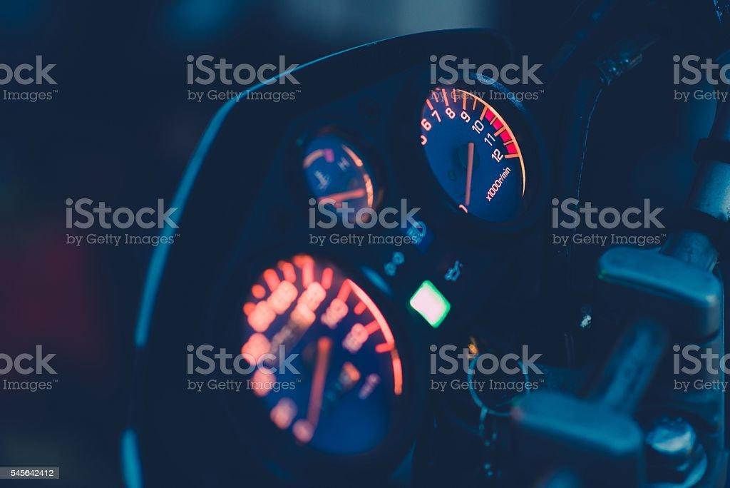 Illuminated motorbike control panel stock photo