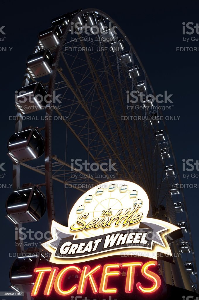 Illuminated neon Great Wheel ticket sign royalty-free stock photo