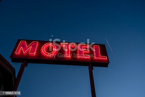 Mid century modern style neon hotel sign with illuminated red letters usually associated with Googie Architecture, a vintage American style circa 1950's