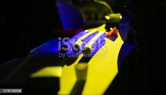 1029436214 istock photo Illuminated neon tube glows in the night 1216135209