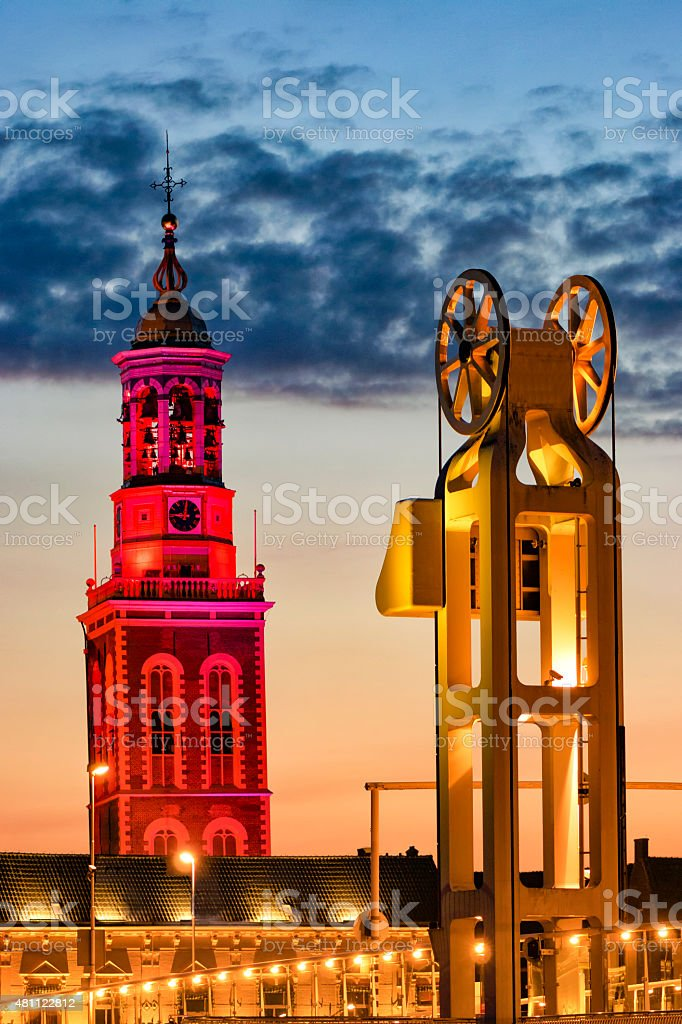Illuminated New Tower and City Bridge in Kampen stock photo
