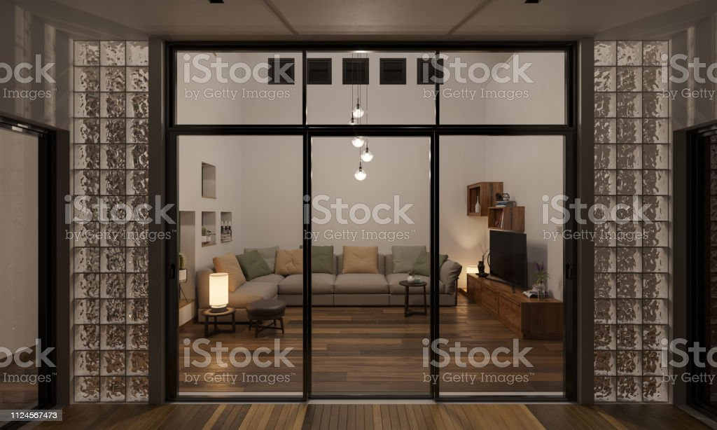 Illuminated Night Time Rendering Of Living Room By The Patio Stock