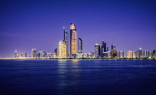 Illuminated nighttime skyline of Abu Dhabi stock photo