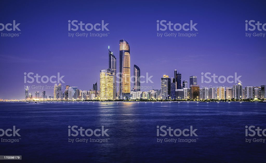 Illuminated nighttime skyline of Abu Dhabi stock photo