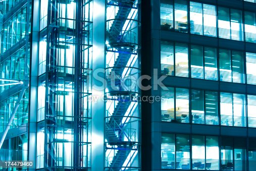 istock Illuminated office building at night, London, England 174479460