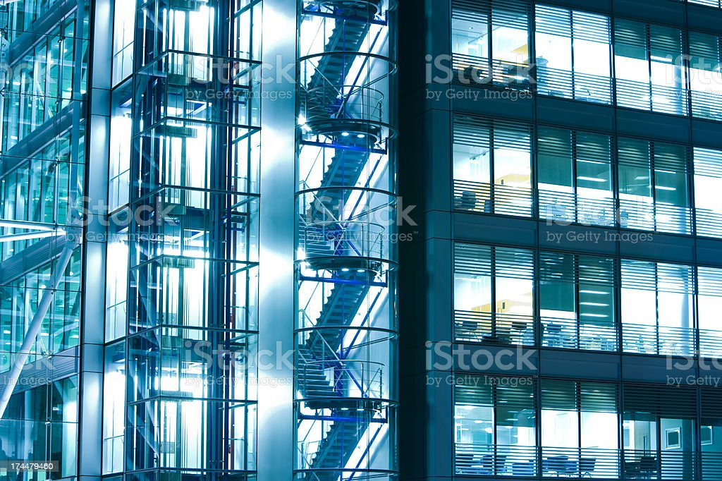 Illuminated office building at night, London, England stock photo