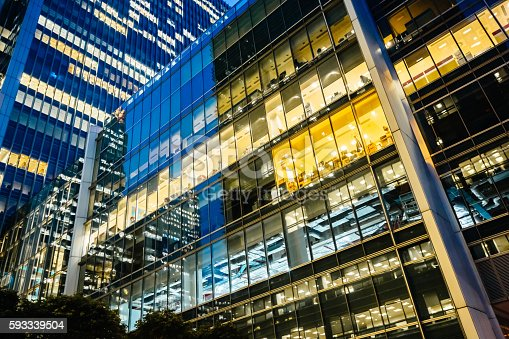 istock Illuminated office buildings at Canary Wharf, London at Night 593339504